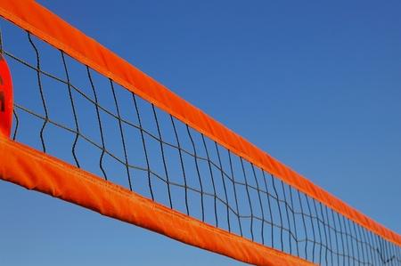 volleyball net: Beach volleyball net against a clear blue sky
