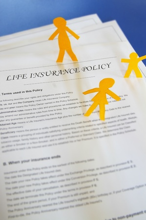 policy document: life insurance policy and paper cutout family