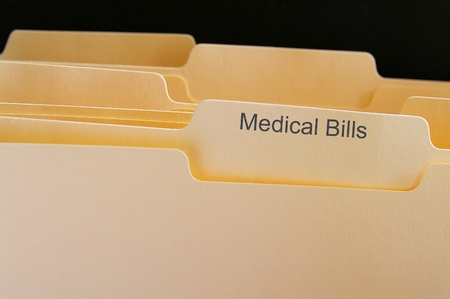 Folders with Medical Bills test, on black photo