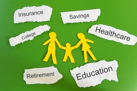 financial insurance: Paper cutout family with expenses on torn paper scraps