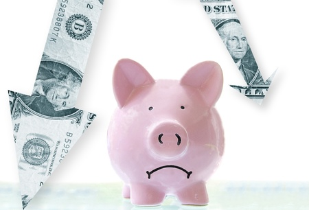 recession: frowning pink piggy bank with downward pointing dollar arrows