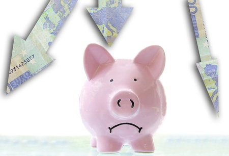 frowning pink piggy bank down Euro arrows photo