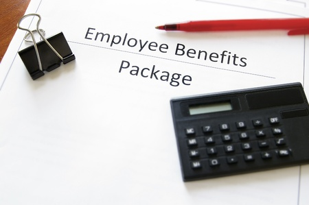 employee benefits package with calculator and pen Imagens