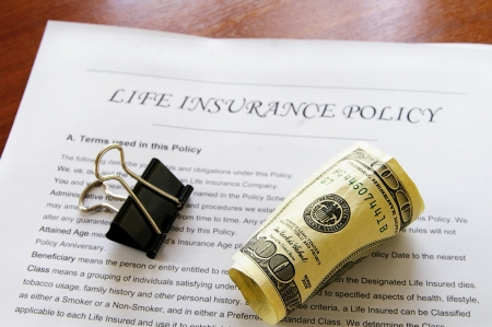 insurance policy: rolled up cash on life insurance policy Stock Photo