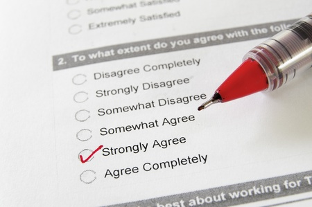agree: closeup of a business survey, with Strongly Agree checked