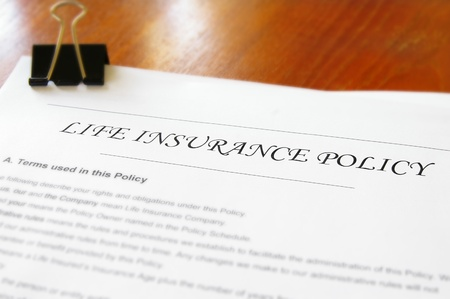 policies: closeup of a life insurance policy on a desk Stock Photo