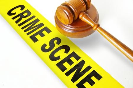 crime scene tape: judges gavel and yellow crime scene tape Stock Photo