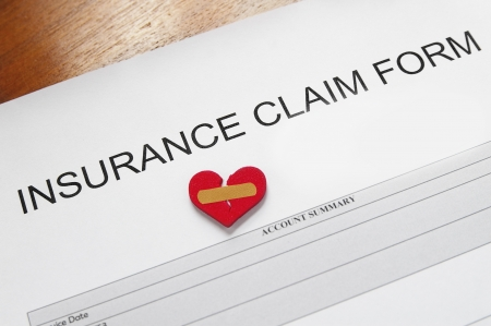 premiums: insurance claim form with bandaged heart  Stock Photo