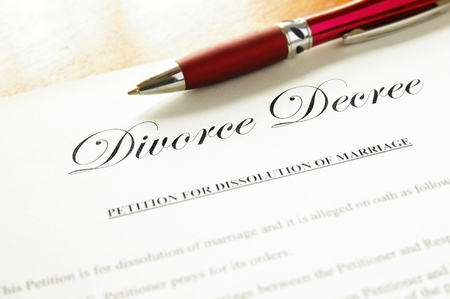 decree: closeup of a divorce decree document with pen Stock Photo