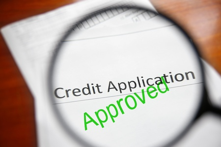 credits: magnifying glass and approved credit application form