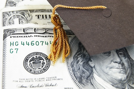 mini graduation cap on money Stock Photo - 13044485