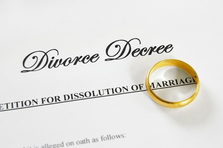 decree: gold wedding ring on a divorce decree Stock Photo