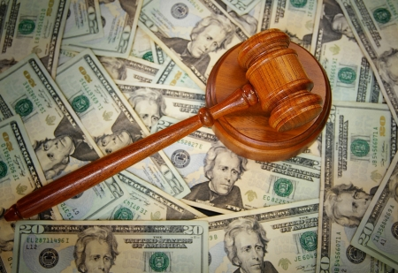sue: court gavel on U S  Twenty dollar bills