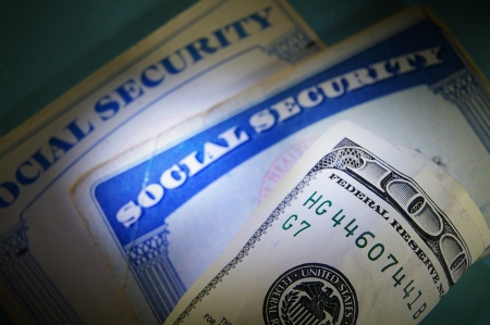 social security: US money and Social Security cards