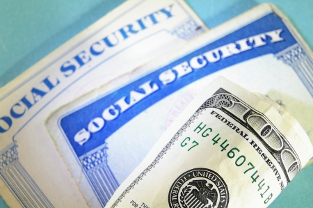 US Social Security cards and money, close up photo