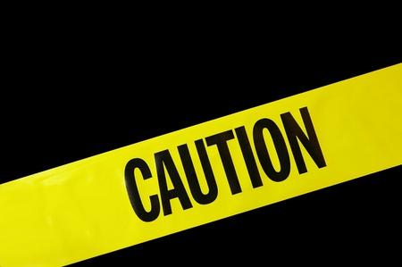 yellow caution tape on black background Stock Photo - 13216206