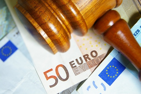 sue: Closeup of a gavel and Euro notes Stock Photo