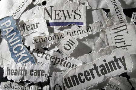 current events: various newspaper headlines showing economic concepts