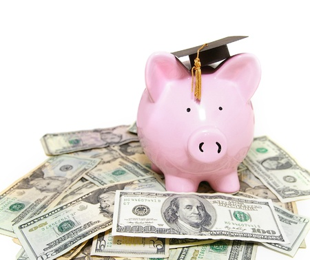 scholarship: piggy bank with graduation cap, on cash Stock Photo