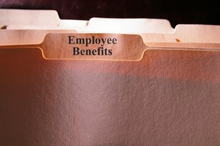 employees working: folders with Employee Benefits text Stock Photo
