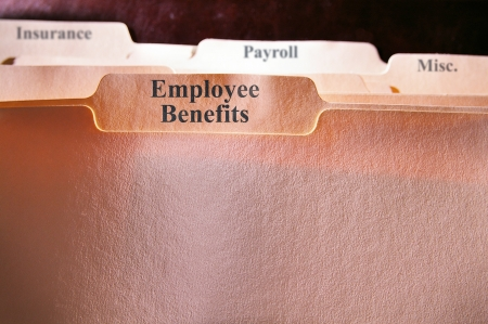 file folders with Employee Benefits text photo