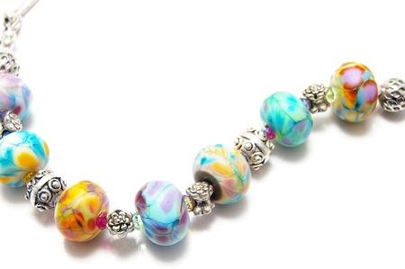 bead jewelry: unique bead necklace on white background Stock Photo