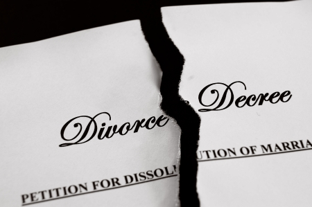 decree: Divorce decree document torn apart Stock Photo