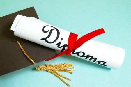 diplomas: mini graduation cap and diploma Stock Photo
