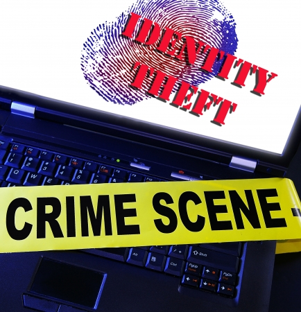 id theft: laptop fingerprint with Identity Theft text