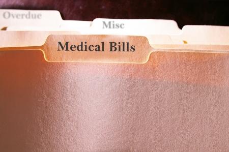 medical bills: tabbed folders with Medical Bills text