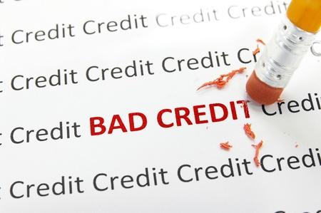 erasing: macro pencil erasing bad credit Stock Photo