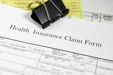 Health insurance claim form and medical bills photo