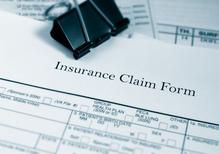 financial insurance: Insurance claim form and bills Stock Photo