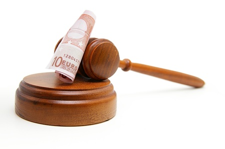 arbitrater: Euro note and court gavel, on white