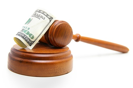 judges court gavel and hundred dollar bill, on white photo