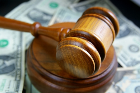 arbitrater: closeup of a court gavel on cash Stock Photo