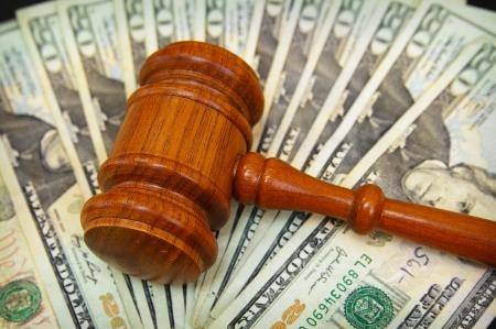 court gavel on an array on money photo
