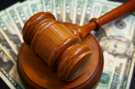 judges gavel on an array of cash