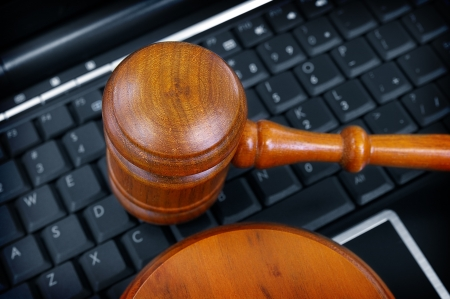 court gavel on laptop computer keyboard photo