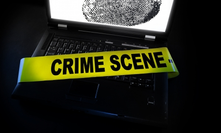 laptop fingerprint with crime scene tape across it Stock Photo - 15081718