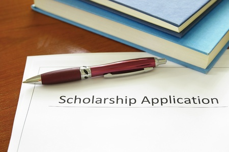 school scholarship application form and books photo