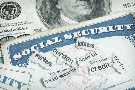 current events: newspaper headlines and social security cards with cash