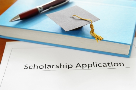 university application: school scholarship application form  and education items