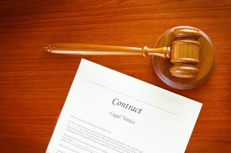 judges gavel and a contract document Stock Photo - 15380456
