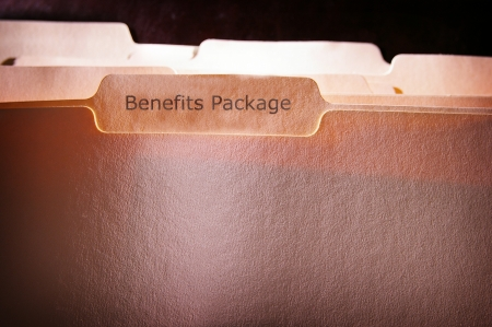 file folders with Benefits Package text