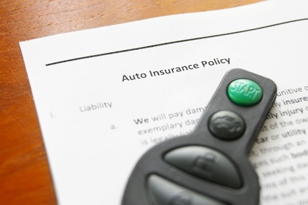 key fob: electronic car key fob on an auto insurance policy