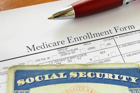 social security: Social Security card and Medicare enrollment form Stock Photo