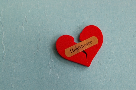 broken heart with a bandage and Healthcare text