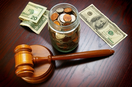 legal gavel with cash and coins - legal or divorce concept photo