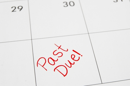 due date: Closeup of a calendar with Past Due text